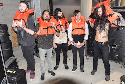 Pop Evil poses with lifejackets for the Life Looks Good On You campaign
