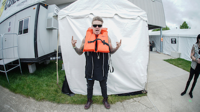Jacoby Shaddix of Papa Roach poses with lifejacket for the Life Looks Good On You campaign