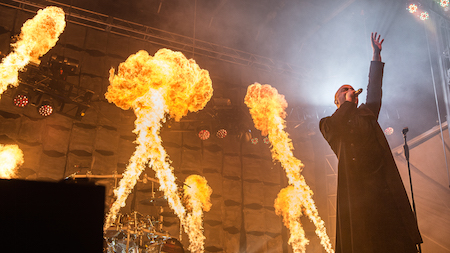 Flames shoot up behind Disturbed singer David Draiman at LOUDER THAN LIFE, photo by Andrew FOre
