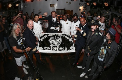 Motörhead presented with a 40th Anniversary cake on the deck of Norwegian Pearl