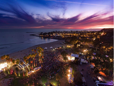 Aerial photo of an event crowd at Doheny State Beach at sunset