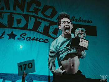 Takeru Kobayashi celebrating victory at Sabroso Craft Beer, Taco & Music Festival powered by Gringo Bandito
