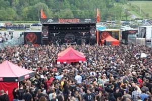 Wide shot of a large crowd gathered in front of the outdoor Jägermeister Second Stage at the Rockstar Energy Drink UPROAR Festival. Photo by Strati Hovartos.