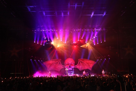 Avenged Sevenfold performing live at UPROAR in front of the band's winged skull backdrop