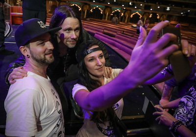 Alter Bridge's Myles Kennedy posing for a selfie with fans on ShipRocked 2017